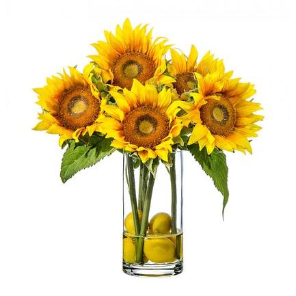 Подсолнухи с лимонами в стеклянной вазе с водой, 38 см
