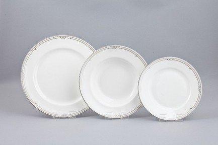 Набор тарелок Ника на 6 персон, 18 пр.Тарелки и Блюдца<br>Набор элегантных тарелок из 18 предметов на 6 персон. Идеален для торжественной сервировки стола. Каждая тарелка в наборе выполнена с прекрасным вкусом и изяществом. Тонкое исполнение подчеркивает удивительную природную красоту фарфора.<br><br>Серия: Ника<br>Состав: Тарелка подстановочная - 6 шт.,  Тарелка суповая - 6 шт., Тарелка закусочная - 6 шт.