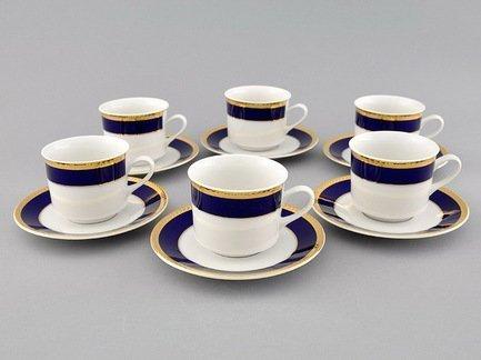 Набор чашек Сабина Сине-золотая лента (0.2 л) с блюдцами, 6 шт.Чашки и Кружки<br>Отличный набор для чая и кофе, рассчитанный на 6 персон. Вместительные фарфоровые чашки прекрасно подходят для горячих ароматных напитков, а блюдца изящно дополнят выполненную со вкусом сервировку стола.<br><br>Серия: Сабина Сине-золотая лента<br>Состав: Чашки (0.2 л) - 6 шт., Блюдца - 6 шт.