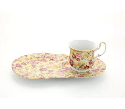 Сервиз чайный для завтрака Моника, 2 пр.Чайные сервизы<br>Изящный набор для завтрака включает два предмета: элегантную чашечку и оригинальную сдвоенную тарелку с блюдцем. Вся посуда выполнена в едином стиле и эффектно оформлена яркими цветочными рисунками на бежевом фоне. Украшают посуду тонкие золотистые ободки.<br><br>Серия: Моника<br>Состав: Кружка чайная - 1 шт., Блюдце-поднос - 1 шт.