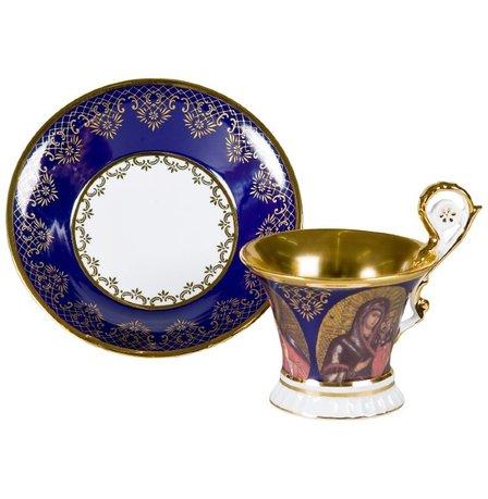 Чашка высокая Улрика (0.2 л) с блюдцемЧашки и Кружки<br>Эта элегантная фарфоровая чашка с изящным декором темно-синего цвета прекрасно подходит для чая, а миниатюрное блюдце эффектно дополняет элегантный комплект посуды и может использоваться для пирожных, печенья или других сладостей.<br><br>Серия: Улрика