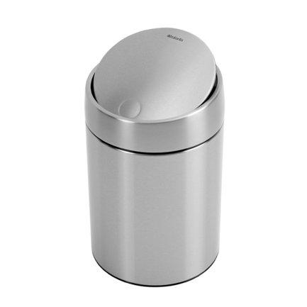 Ведро для мусора с крышкой Slide (5 л), 31.5х20.5х21.8 см, стальной матовый, с защитой от отпечатков пальцевМусорные ведра<br>Стильный мусорный бак со стальной вращающейся крышкой компактен и практичен. Его объема – 5 литров – достаточно для ежедневного сбора мусора в туалете и ванной комнате. Корпус бака изготовлен из качественной нержавеющей стали, устойчивой к появлению коррозии. Это именно то, что нужно для сбора мусора в условиях повышенной влажности в помещении. Главная особенность бака – в практичных деталях, которые делают его очень удобным. Бак можно традиционно поставить на пол в любом подходящем месте, а можно прикрепить к стене, например, возле умывальника на уровне рук. Для этого в комплекте идет держатель из нержавеющей стали, на него контейнер надевается своей задней стенкой. Внутрь бака вставляется пластиковое ведро, на которое надевается мусорный пакет. Съемное ведро легко содержать в чистоте: оно удобно вынимается и моется. На дне бака есть специальное пластиковое кольцо, благодаря чему металлический корпус не царапает пол и стоит очень устойчиво даже на мокром покрытии. На баке установлена вращающаяся крышка, она не пропускает запах, удобно открывается и закрывается легким прикосновением.<br><br>Серия: Slide Bin