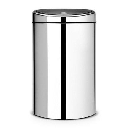 Мусорный бак Touch Bin (40 л), 44х30.5х71.5 см, стальной полированныйМусорные баки<br>Этот вместительный мусорный бак Brabantia Touch Bin занимает минимум пространства и выглядит стильно. Пространство экономится за счет того, что задняя стенка бака плоская, что позволяет подвинуть бак вплотную к стене. Дизайн бака позволяет ему не прятаться укромно в уголке, а занять любое удобное для вас место на кухне дома или в другом помещении. Эта модель не только красива, но и практична. Корпус изготовлен из стальной полированной нержавеющей стали. Благодаря системе Soft-Touch пользоваться баком удобно: легким движение руки вы мягко и бесшумно откроете и закроете крышку. У этой модели есть защитное основание из пластмассы, благодаря которому стальной корпус не царапает пол. Внутри бака устанавливается съемное пластиковое ведро, на которое надевается мусорный мешок. Для этой модели подходят мешки размера L. В корпусе съемного ведра есть специальные отверстия для вентиляции, и полный пакет с мусором благодаря этим отверстиям вынимается из ведра без образования вакуума.<br><br>Серия: Touch Bin