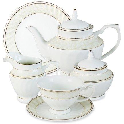 Чайный сервиз Адель на 6 персон, 21 пр.Чайные сервизы<br>Традиционное чаепитие – неотъемлемая часть общения в кругу семьи и друзей. Чайный сервиз Адель от тайского производителя Emerald имеет все необходимые предметы, чтобы сделать чайную церемонию эстетичной, удобной и беззаботной. Изумительно белый фарфор в руках тайских мастеров принял формы изысканного чайничка, очаровательных чашек и блюдец. Стараниями художников атмосфера, создаваемая оформлением сервиза, окутывает всех присутствующих на чаепитии красотой и уютом.<br><br>Серия: Адель<br>Состав: Чашка (0.2 л) - 6 шт., Блюдце - 6 шт., Тарелка, 19 см - 6 шт., Чайник (1.2 л), Сахарница (0.45 л), Молочник (0.3 л)