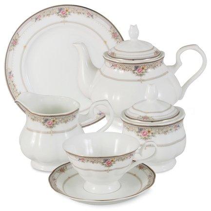 Чайный сервиз Лэнсбери на 6 персон, 21 пр.Чайные сервизы<br>Традиционное чаепитие – неотъемлемая часть общения в кругу семьи и друзей. Чайный сервиз Лэнсбери от тайского производителя Emerald имеет все необходимые предметы, чтобы сделать чайную церемонию эстетичной, удобной и беззаботной. Изумительно белый фарфор в руках тайских мастеров принял формы изысканного чайничка, очаровательных чашек и блюдец. Стараниями художников атмосфера, создаваемая оформлением сервиза, окутывает всех присутствующих на чаепитии красотой и уютом.<br><br>Серия: Лэнсбери<br>Состав: Чашка (0.2 л) - 6 шт., Блюдце - 6 шт., Тарелка, 18 см - 6 шт., Чайник (1.5 л), Сахарница (0.35 л), Сливочник (0.3 л)