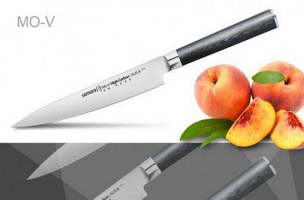 Нож универсальный Samura Mo-V, 27 см, длина лезвия 15 см, вес 155 гКухонные ножи<br>Отличный нож, который станет вашим универсальным помощником по кухне. Он одинаково хорошо справляется с такими кухонными операциями как нарезка, очистка, разделка и шинковка. Эргономичная ручка удобно лежит в ладони и не скользит во время работы.  Характеристики Материал лезвия: сталь Aus 8, Твердость по шкале Роквелла (Hrc) : 57-59, Тип режущей кромки лезвия: двусторонняя симметричная, Материал рукояти : стеклотекстолит G-10, Угол заточки (гр.) : 20<br><br>Серия: Mo-V