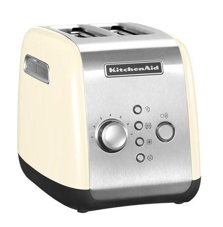 Тостер кремовый KMT221, загрузка 2 хлебца, кремовыйТостеры<br>Новая модель 2014 года. Яркий, практичный и функциональный тостер предназначен для одновременного приготовления двух тостов. Корпус тостера изготовлен из стали. Несмотря на то, что эта новая модель отличается на вид от более привычного тостера Artisan, фирменный американский китченэйдовский стиль был сохранен.     Температура регулируется поворотом хромированной ручки. Всего здесь предусмотрено 7 степеней поджаривания, также есть отдельная кнопка, включающая режим размораживания. Вы можете готовить хрустящие тосты не только из свежего хлеба, но и из замороженного. Тостер правильно разморозит каждый ломтик и поджарит его.     Отверстие решетки для тостов широкие, так что в них вы сможете поджаривать и классические плоские кусочки хлеба - тосты, и разнообразные булочки и бейглы. Кроме того, для приготовления булочек и бейглов есть специальная функция, включив которую вы сможете получить подогретые снаружи и поджаренные изнутри булочки - идеальные для намазывания различными начинками. В этой модели есть функция ручного поднятия тостов. Нажав на кнопку Приготовление/Отмена, вы сможете вручную опустить и поднять выпечку.     С этим тостером у вас нет необходимости торопливо вынимать горячие кусочки хлеба, как только они будут готовы. Здесь есть режим подогрева, с которым готовые тосты будут подогреваться и останутся теплыми в течение 3 минут после приготовления.     Характеристики:   Поддон для крошек выдвижной  Гарантия: 2 года<br>